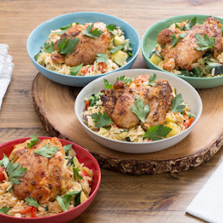 Seared Chicken Thighs with Mediterranean Orzo Salad.