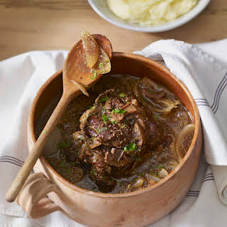 Dutch Oven Pot Roast with Vegetables and Herbs.