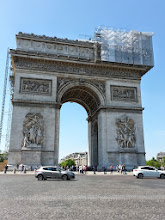 Photo: Arc de Triomphe -Built in 1836, a lamp's lit daily at 6:30pm at the Tomb of Unknown Soldier monument, honoring the 1.5 million Frenchmen who died in WWI. Original architect wanted a giant bejeweled elephant but Napoleon stepped in.