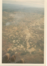 Photo: View of heavily defoliated and heavily bombed landscape of I Corps area taken somewhere near Khe Sanh.  Taken during evacuation of A Battery 1/77 from LZ Peanuts on May 5, 1968.