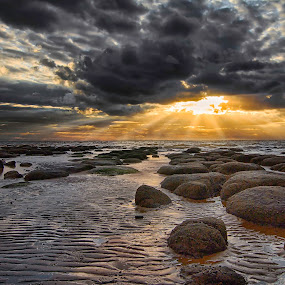 Sunset Rocks by Jan Murphy - Landscapes Cloud Formations ( clouds, sand, sunset, moody, sea, beach, rocks, rays )