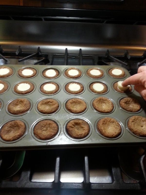 Bake about 8-10 minutes.Take pan out of oven and press a peanut butter cup...