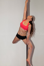 Photo: Vertical Pole Gymnastics - Carousel Spin with Body Wrap Extension