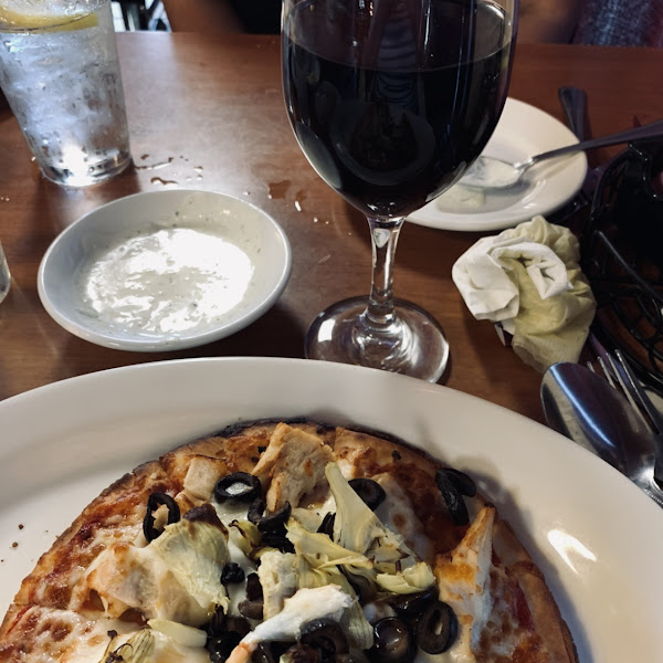 """Smaller 8"""" pizza also comes in 12"""" too. Thin crust also available as cauliflower version. All are GF and DF (w/out adding cheese to your pizza). Very fresh toppings but black olives tasted canned."""