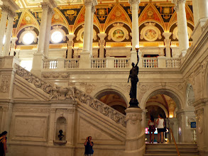 Photo: Twin stairways flank the main entrance of the Library of Congress.  This is the stairway on the south side of the room.  The bronze bust in the niche is Washington.