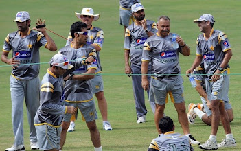 Photo: Pakistan cricket coach Dav Whatmore (2R) shares a light moment with players during a practice session at the R. Premadasa Stadium in Colombo on June 15, 2012.  The remaining two matches in the one-day series between Sri Lanka and Pakistan will have reserve days due to rains in the country, Sri Lanka Cricket (SLC) announced. The last two day-night games of the five-match series are scheduled to be played in Colombo on June 16 and 18 with rain forecast for both days.   AFP PHOTO/ LAKRUWAN WANNIARACHCHI        (Photo credit should read LAKRUWAN WANNIARACHCHI/AFP/GettyImages)