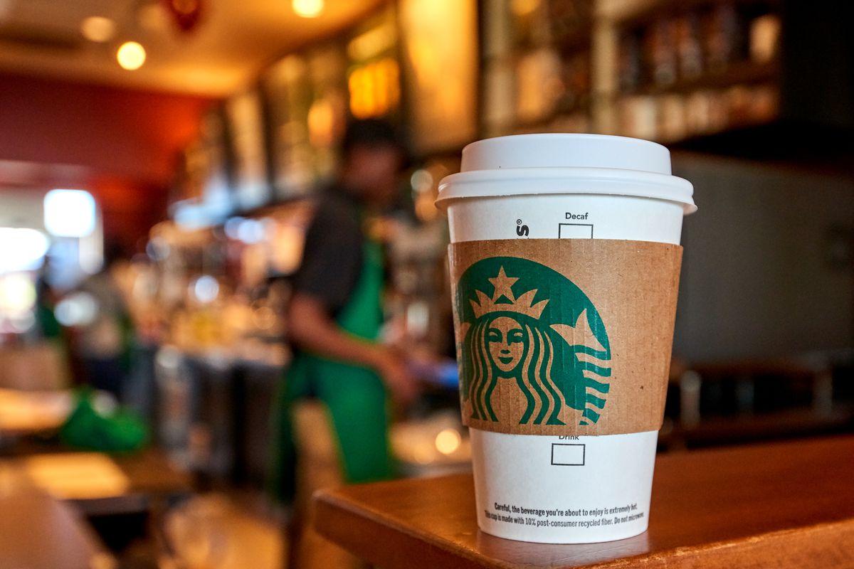 Starbucks coffee cup on a Starbucks counter.