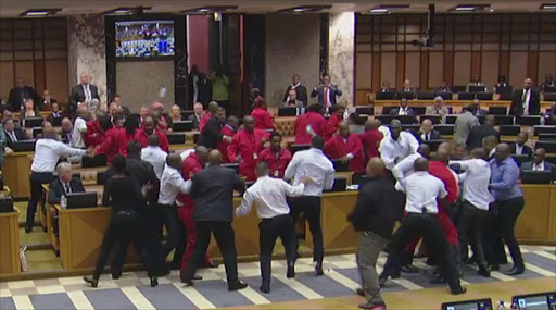 EFF MPs fight with security services who were ordered to throw them out of parliament.