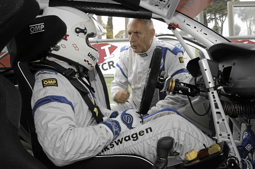 Getting a bit of advice from the legend Hans-Joachim Stück.    Picture: VOLKSWAGEN MOTORSPORT
