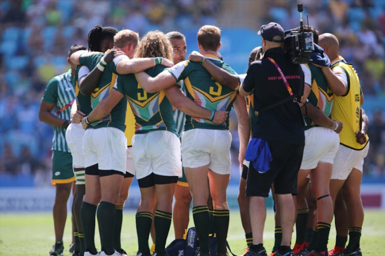 Neil Powell, coach of South Africa, chats to his players during half time during the Rugby 7's semi final match between South Africa and Fiji on day 11 of the Gold Coast 2018 Commonwealth Games at the Robina Stadium on April 15, 2018 in Gold Coast, Australia.
