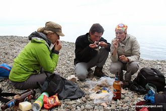 Photo: The gang maws some delicious smoked fish, bread, and cheese on the Baikal lakeside during a short break in the tour