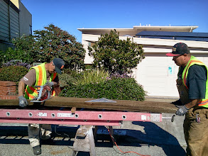 Photo: San Francisco Department of Public Works carpenters David (left) and Francisco (right) cutting another section of an erosion-control barrier on October 4, 2013. Installation of the barriers is nearing completion on the final area of Hidden Garden Steps site (16th Avenue, between Kirkham and Lawton streets in San Francisco's Inner Sunset District) in need of attention before the Hidden Garden Steps 148-step ceramic-tile mosaic designed and created by artists Aileen Barr and Colette Crutcher is installed. For more information about this volunteer-driven community-based project supported by the San Francisco Parks Alliance, the San Francisco Department of Public Works Street Parks Program, and hundreds of individual donors, please visit our website at http://hiddengardensteps.org.