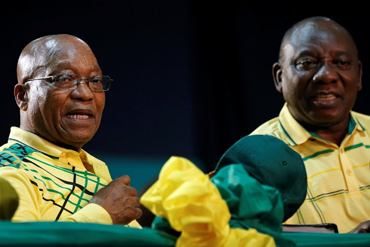 President of South Africa Jacob Zuma sits next to his deputy Cyril Ramaphosa at the 54th National Conference of the ruling African National Congress (ANC) at the Nasrec Expo Centre in Johannesburg, on December 16, 2017.