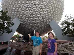 "Photo: Next stop: Epcot! Julia thought it would be fun to ""hold"" the Epcot ball"
