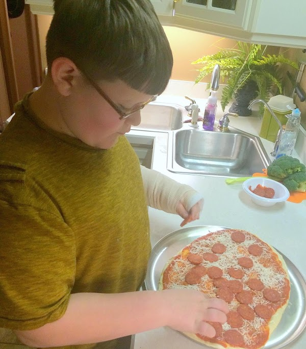 Feb. 7th, 2015 --- Noah adding your cheese and pepperoni.