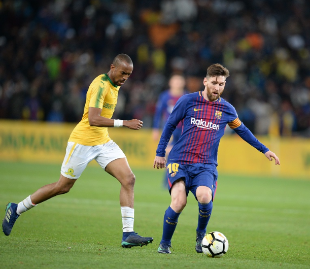 Lionel Messi, who came on for the last 15 minutes, glides past Mamelodi Sundowns' Tiyani Mabunda at FNB Stadium on Wednesday. Picture: GALLO IMAGES