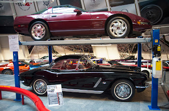Photo: 1993 Ruby Red 40th Anniversary Corvette (top) 1962 Black Corvette (bottom)  before. permission is granted for the use of this photo.