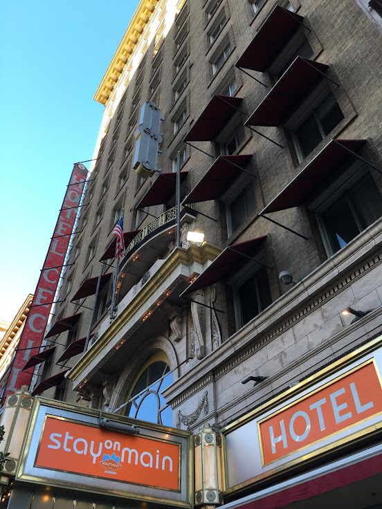 Front facade of the Stay on Main Hotel.  The building cannot hide its past.