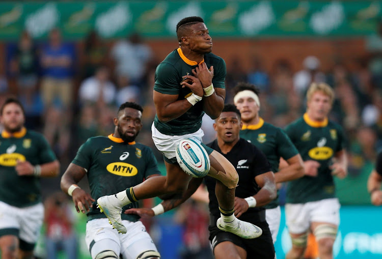 South Africa's Aphiwe Dyantyi collects the high ball during the Rugby Championship match between the Springboks and the All Blacks at Loftus Versfeld in Pretoria on October 6, 2018