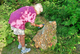 Photo: Sherry tries to get a sample from a nearby boulder.