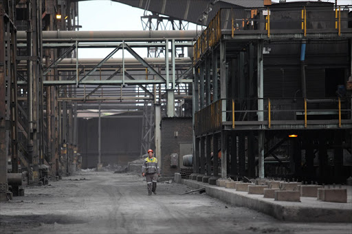 A worker walks inside Evraz Highveld Steel and Vanadium plant in Emalahleni. Picture: SIMON MATHEBULA