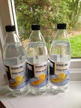 Photo: Back home, with three bottles of sparkling spring water.