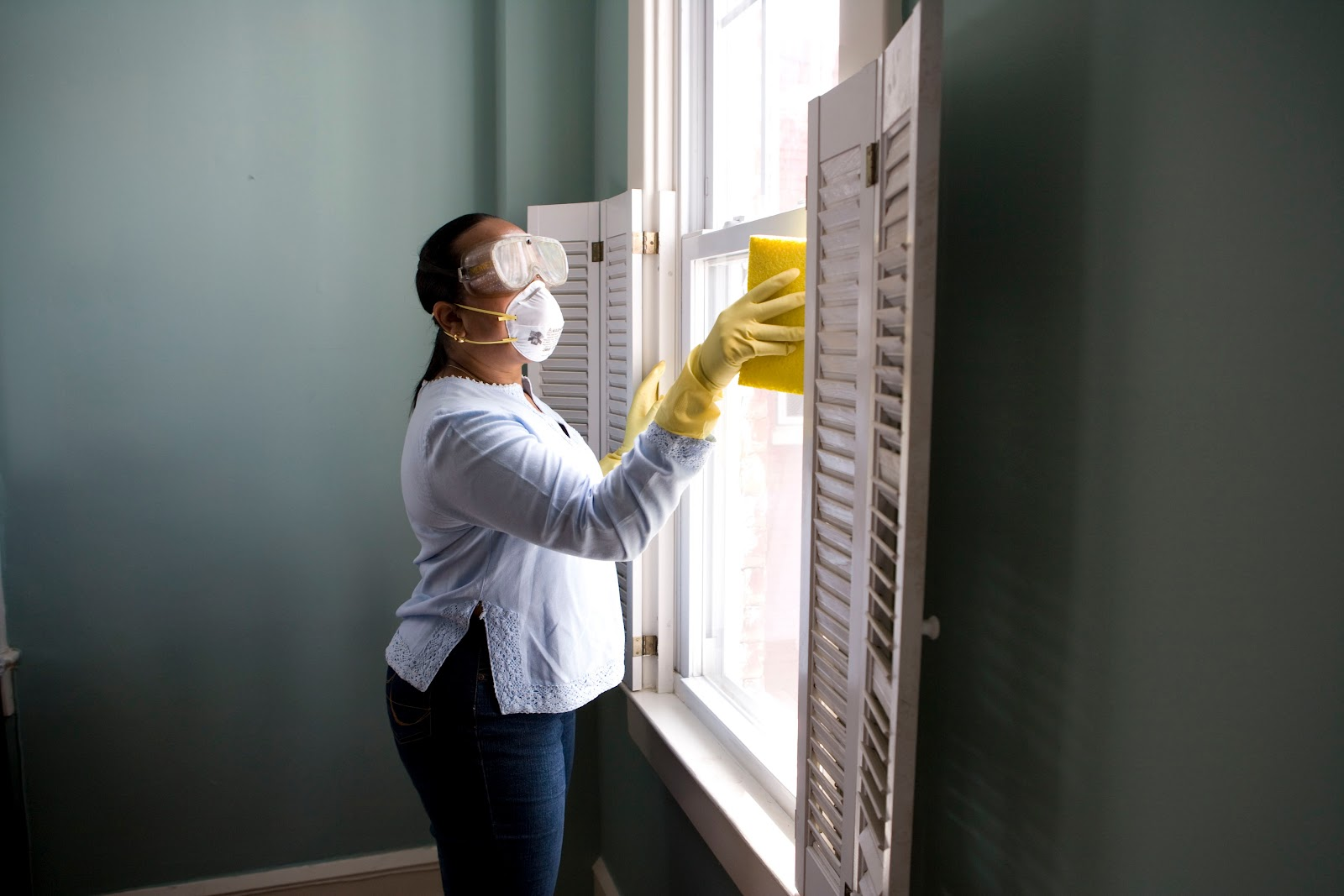 a woman cleaning a room