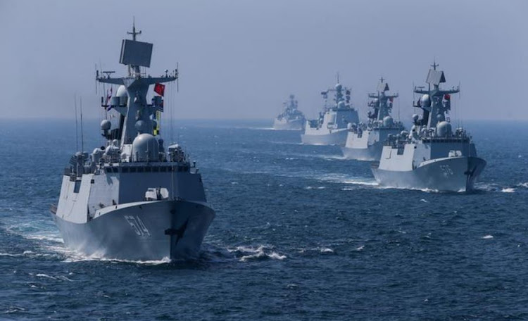 A fleet of ships sail out at sea as China and Russia's naval joint drill concludes in Zhanjiang, Guangdong Province, China, September 19, 2016. REUTERS/Stringer