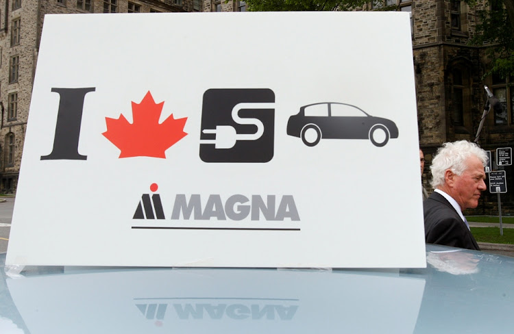 A sign advertises a car being developed in partnership with Magna. Picture: REUTERS