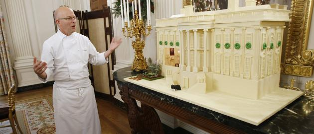 White House Pastry Chef Bill Yosses talks about his gingerbread White House on display in the State Dining Room in Washington December 2, 2009. This year