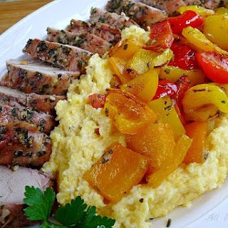 Grilled Pork Tenderloin With Colored Peppers Over Polenta.