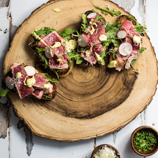 Open-Faced Steak Sandwiches with Parmesan Avocado Cream.