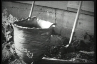 Photo: These photos are actually super 8 mm footage of me destroying the biggest pot I ever threw. I threw it in 4 sections. It was bisque fired by it's self i.e. It took up the entire kiln and it was raku fired with waves of bronze and copper sheen glaze , a team of three of us lifted the red hot pot into the barrel. That is a regular full sized shovel stuck in the dirt a few feet behind the pot.