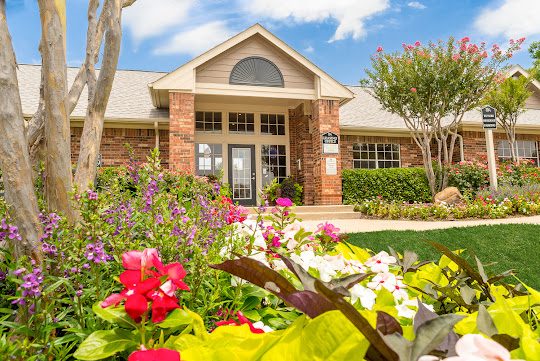 Hebron Trails Apartments leasing office with colorful landscaping