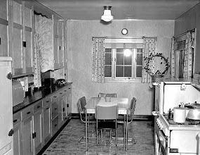 Photo: this photo was taken in 1946. You can see the kind of dinette chairs we commonly associate with the 50's .