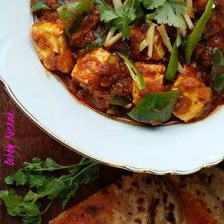 Kadhai Paneer/Cottage Cheese chunks in spicy tomato gravy