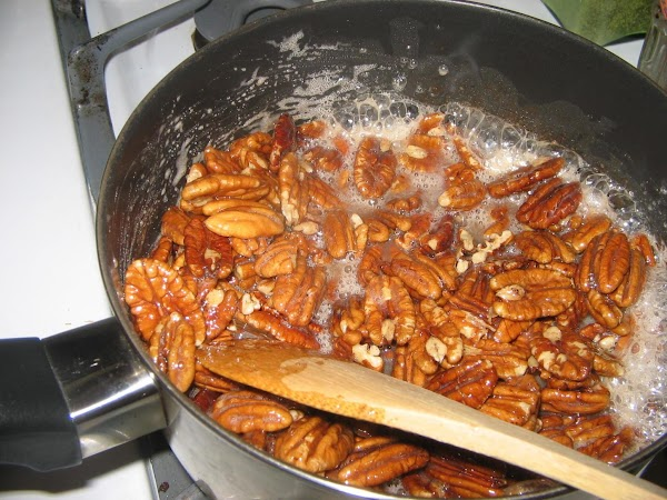 Add nuts and continue to cook and stir until nuts are completely sugared with...