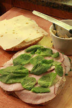 Photo: Layer your focaccia: artichoke spread, lunch meat, spinach leaves, cheese.