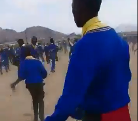 In the video a group of pupils appear to chase another group with what appears to be pangas.