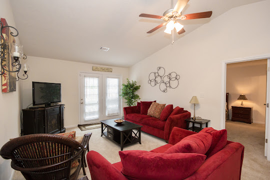 Living room with red couch and love seat