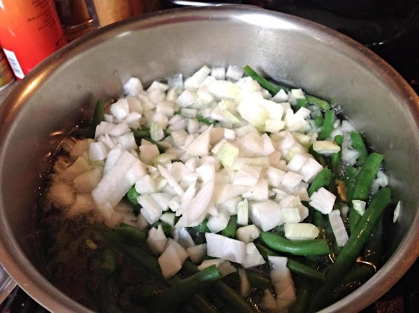 Peel & Chop the onions, & then add to pot of green beans. Add...