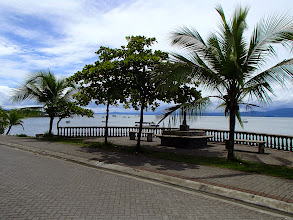 Photo: Promenade along the Golfo Dulce at Puerto Jimenez. Collapsed sidewalk from storm our first day is to the left.