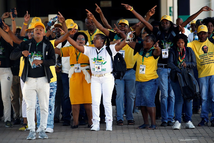 Delegates chant slogans as they arrive for the 54th National Conference of the ruling ANC at the Nasrec Expo Centre in Johannesburg. Picture: REUTERS/SIPHIWE SIBEKO