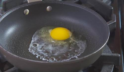 Crack egg into skillet and turn heat to low. If you're using...