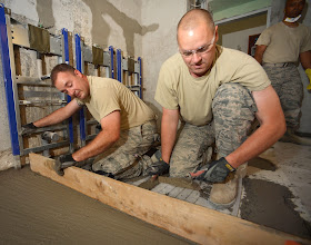 Photo: U.S. Air Force Senior Master Sgt. Kurt Huver, left, and Tech. Sgt. Tim Leick, right, 133rd Civil Engineering Squadron, level a concrete floor at an elementary school in Ogulin, Croatia, June 25, 2014. The school bathrooms are being renovated by Airmen from the 133rd and 148th Civil Engineering Squadron, and 219th Red Horse Squadron in partnership with the Croatian Army. Croatia is a Minnesota State Partner under the National Guard State Partnership Program. (U.S. Air National Guard photo by Staff Sgt. Austen Adriaens/Released)