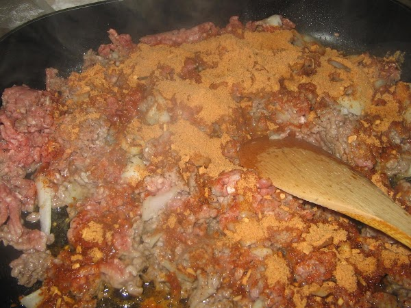 Add  to the  meat mixture 1/2 the diced onion,1 packet of the...