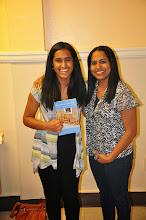 Photo: Maya Ganesan shows off the RASP poetry anthology.