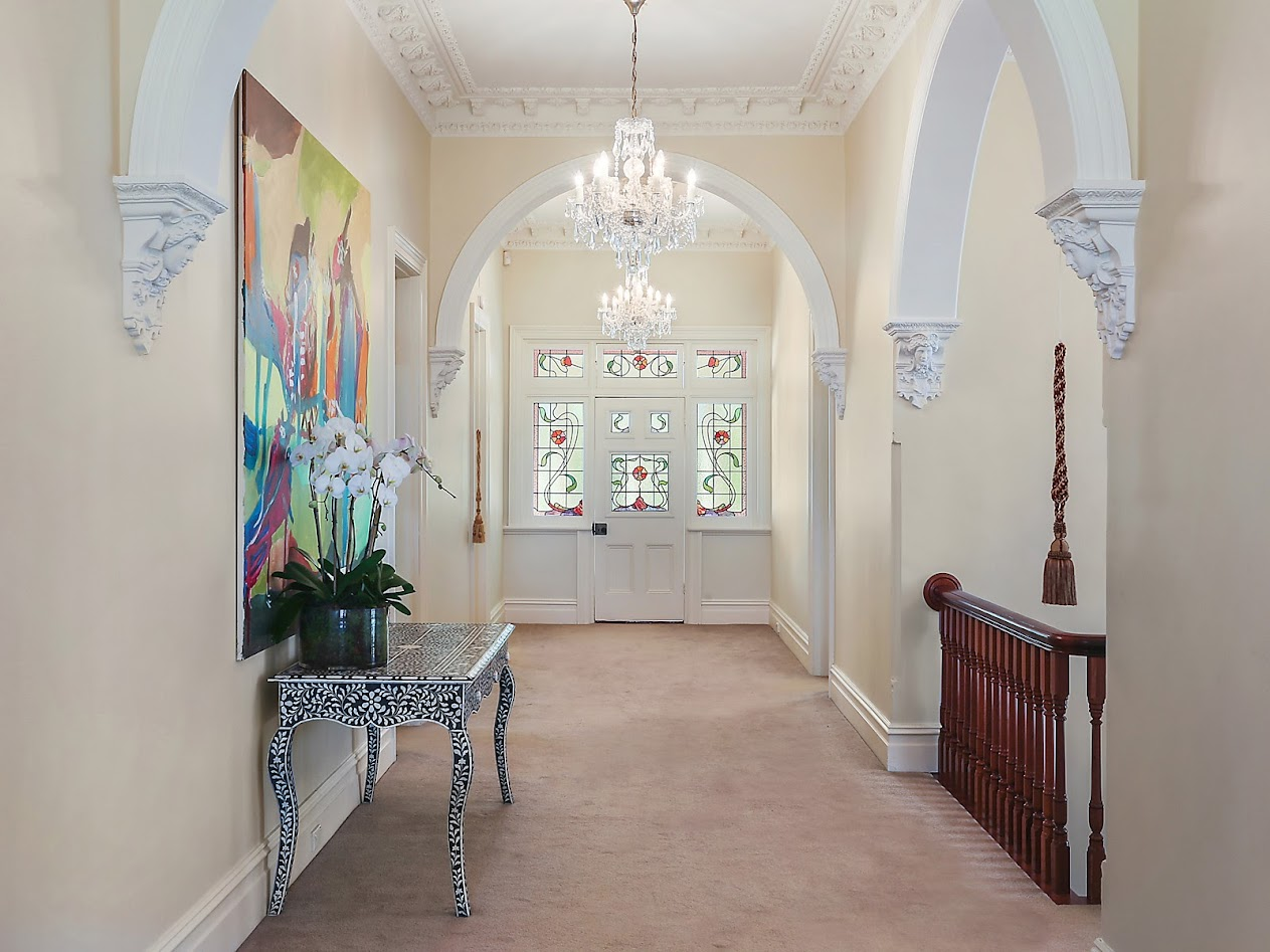Exquisite marble entrance foyer with classic arched hallway