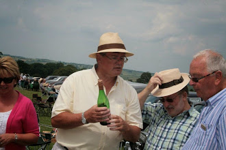 Photo: Keith Davies checks to see if David Clarke and Derek Freeman can afford his bottle of wine