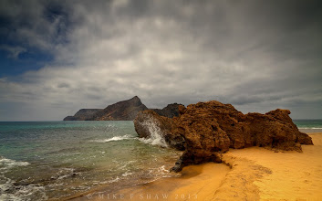 Photo: Grind Me Down  Watching the waves hit this small outcrop of sandstone in Porto Santo in Portugal and then feeling the sand beneath my feet you realise they are one and the same. The sea has taken its toil on the outcrop turning it to sand but its a beautiful destruction.  Nature will change its environment to fit whats needed, we need to take notice of how it should be done.  We got home in the early hours of this morning from a wonderful holiday, did you miss me ;)